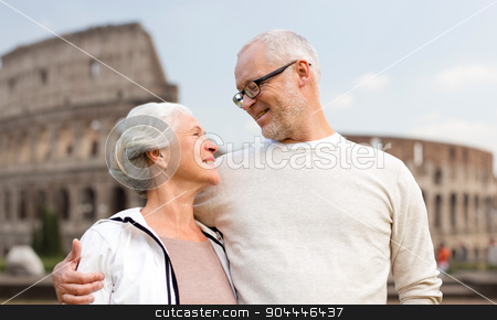 happy senior couple over coliseum in rome, italy stock photo, family, tourism, travel and people concept - happy senior couple over coliseum in rome, italy by Syda Productions