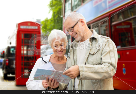 senior couple with map on london in city street stock photo, family, age, tourism, travel and people concept - senior couple with map over london city street background by Syda Productions