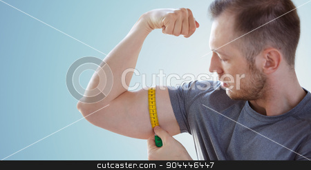 close up of male hands with tape measuring bicep stock photo, sport, fitness, bodybuilding and people concept - close up of male hands with tape measuring bicep over blue background by Syda Productions