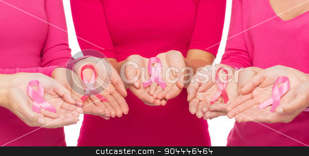 close up of women with cancer awareness ribbons stock photo, healthcare, people and medicine concept - close up of women in blank shirts with pink breast cancer awareness ribbons over white background by Syda Productions