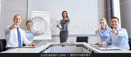 group of businesspeople pointing finger at you stock photo, business, people and teamwork concept - group of smiling businesspeople meeting and pointing finger at you in office by Syda Productions