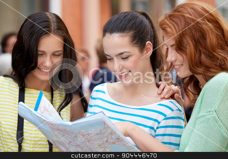 smiling teenage girls with map and camera outdoors stock photo, tourism, travel, leisure, holidays and friendship concept - smiling teenage girls with map and camera outdoors by Syda Productions