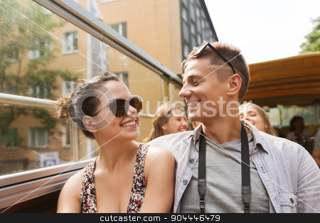 smiling couple traveling by tour bus stock photo, travel, tourism, summer vacation, sightseeing and people concept - smiling teenage couple in sunglasses traveling by tour bus by Syda Productions