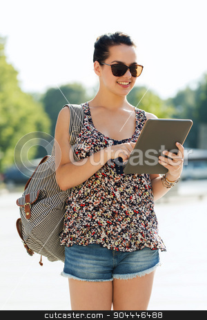 happy teenage girl with tablet pc and backpack stock photo, tourism, travel, summer holidays and people concept - happy teenage girl with tablet pc computer and backpack in city by Syda Productions