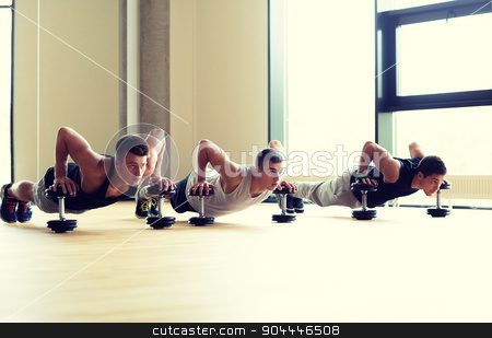 group of men with dumbbells in gym stock photo, sport, fitness, lifestyle and people concept - group of men with dumbbells in gym by Syda Productions