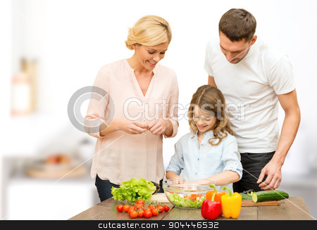 happy family cooking vegetable salad for dinner stock photo, vegetarian food, culinary, happiness and people concept - happy family cooking vegetable salad for dinner over kitchen background by Syda Productions