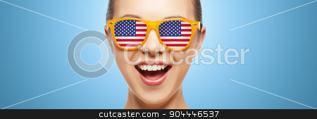 happy teenage girl in glasses with american flag stock photo, people, patriotism, national pride and independence day concept - happy teenage girl in sunglasses with american flag by Syda Productions