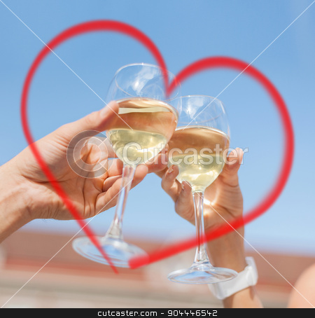 couple drinking wine in cafe stock photo, summer holidays and dating concept - couple drinking wine in cafe in the city by Syda Productions