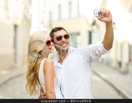 travelling couple taking photo picture with camera stock photo, summer holidays, travel, vacation, tourism and dating concept - travelling couple taking photo picture with camera by Syda Productions