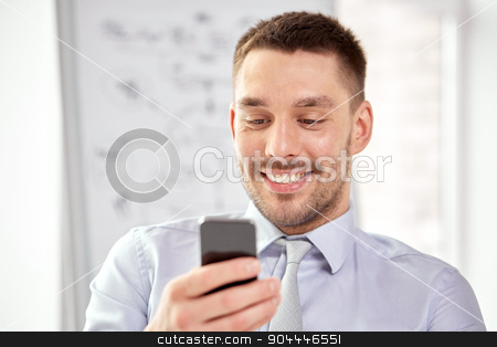 young smiling businessman with smartphone stock photo, business, technology, internet and communication concept - young smiling businessman texting message on smartphone by Syda Productions