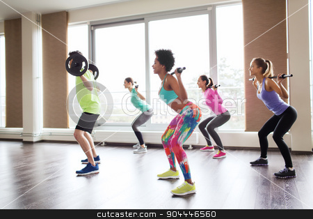 group of people exercising with barbell in gym stock photo, fitness, sport, training, gym and lifestyle concept - group of people exercising with barbell and bars in gym by Syda Productions