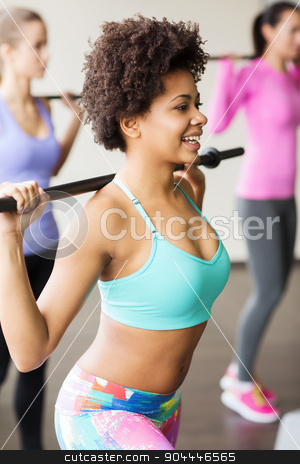 group of people exercising with bars in gym stock photo, fitness, sport, training, gym and lifestyle concept - group of people exercising with bars in gym by Syda Productions