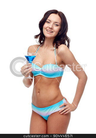 happy young woman in swimsuit drinking cocktail stock photo, people, summer holidays, celebration, drinks and beach concept - happy young woman in bikini swimsuit drinking cocktail at party by Syda Productions