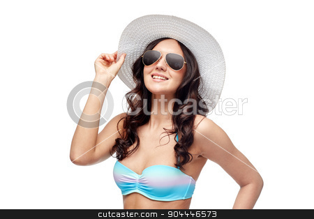 happy young woman in bikini swimsuit and sun hat stock photo, people, fashion, summer and beach concept - happy young woman in bikini swimsuit, sunglasses and sun hat by Syda Productions