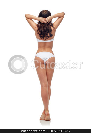 young woman in white bikini swimsuit from back stock photo, people, fashion, swimwear, summer beach and beauty concept - young woman in white bikini swimsuit from back by Syda Productions