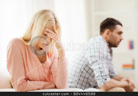 unhappy couple having argument at home stock photo, people, relationship difficulties, conflict and family concept - unhappy couple having argument at home by Syda Productions