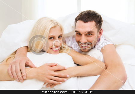 happy couple in bed at home stock photo, people, rest, relationships and happiness concept - happy couple in bed at home by Syda Productions