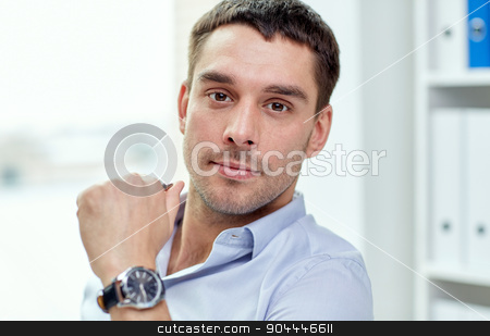 portrait of businessman in office stock photo, business, people and work concept - portrait of businessman in office by Syda Productions