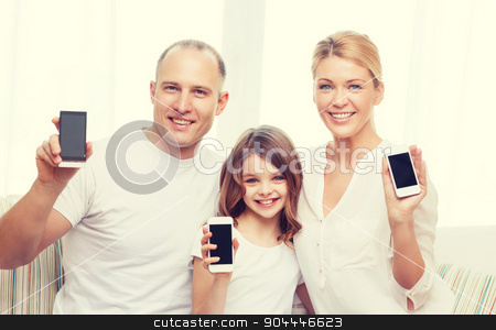 parents and little girl with smartphones at home stock photo, family, child, technology and home concept - smiling parents and little girl with blank black screen smartphones at home by Syda Productions