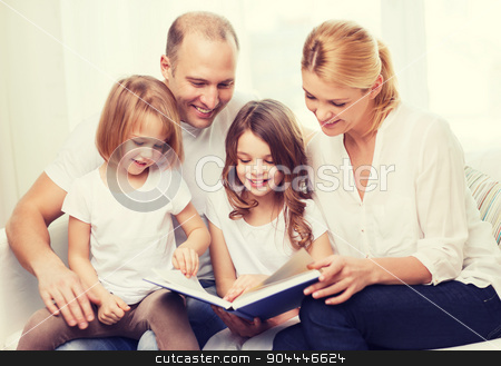 smiling family and two little girls with book stock photo, family, children and home concept - smiling family and two little girls with book at home by Syda Productions