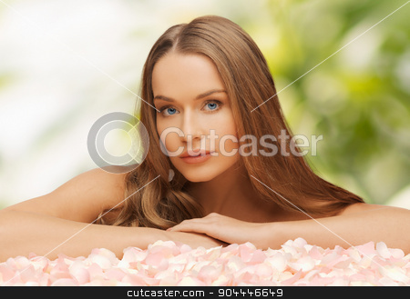 woman with rose petals and long hair stock photo, health and beauty concept - beautiful woman with rose petals and long hair by Syda Productions