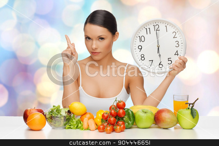 woman with healthy food and clock warning stock photo, people, eating and diet concept - woman with healthy food holding big clock, pointing finger up and warning over blue lights background by Syda Productions