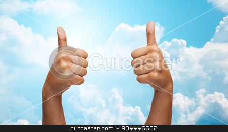 african hands showing thumbs up over blue sky stock photo, gesture, like, success, people and body parts concept - african woman hands showing thumbs up over blue sky and clouds background by Syda Productions
