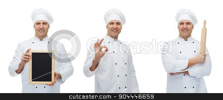 happy male chef baker with menu board showing ok stock photo, cooking, profession, advertisement and people concept - happy male chef cook or baker in toque holding blank menu board, rolling pin and showing ok hand sign by Syda Productions