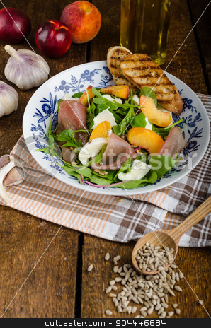 Rocket salad with prosciutto and fruit stock photo, Rocket salad with prosciutto, mozzarella and peaches, panini baguette with bio garlic by Peteer