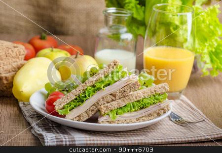 Back to school sandwich stock photo, Back to school sandwich, simple sandwich whole grain bread, salad, ham and cheese. Milk and fresh juice, fruit for bio healthy by Peteer