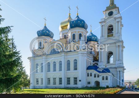 Church of the Holy Trinity under a cloudless blue sky on a sunny summer day stock photo, Bolkhov Orel region, Russia - August 15, 2015: Church of the Holy Trinity under a cloudless blue sky on a sunny summer day by IgorTravkin