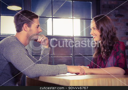Smiling couple talking  stock photo, Smiling couple talking at coffee shop by Wavebreak Media