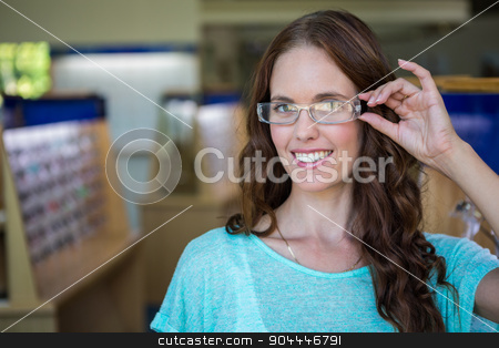 Woman shopping for new glasses stock photo, Woman shopping for new glasses at the optometry store by Wavebreak Media