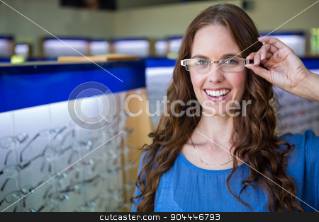 Pretty woman shopping for new glasses stock photo, Pretty woman shopping for new glasses at the optometry store by Wavebreak Media