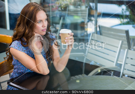 Pretty brunette with take away cup stock photo, Pretty brunette with take away cup in a coffee shop by Wavebreak Media