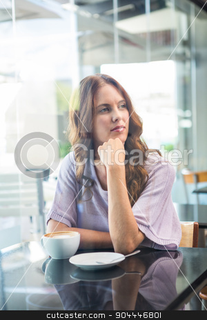Pretty brunette enjoying a coffee stock photo, Pretty brunette enjoying a coffee in a coffee shop by Wavebreak Media