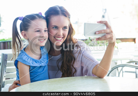 Mother and daughter taking selfie at cafe terrace stock photo, Mother and daughter taking selfie at cafe terrace on a sunny day by Wavebreak Media