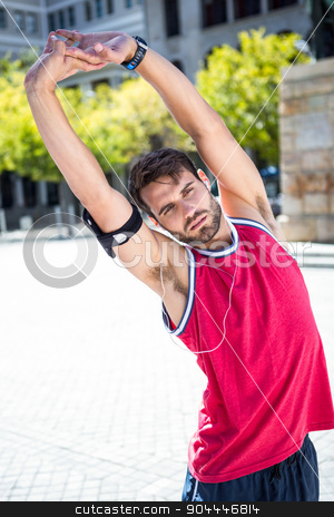 Handsome athlete doing arms stretching stock photo, Portrait of an athlete doing arms stretching on a sunny day by Wavebreak Media