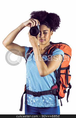 Young woman with backpack taking picture  stock photo, Young woman with backpack taking picture against a white background by Wavebreak Media