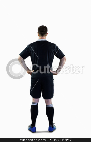 Rugby player with hands on hips stock photo, Back view of a rugby player with hands on hips by Wavebreak Media