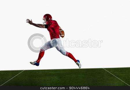 American football player playing football stock photo, American football player playing football on american football field by Wavebreak Media