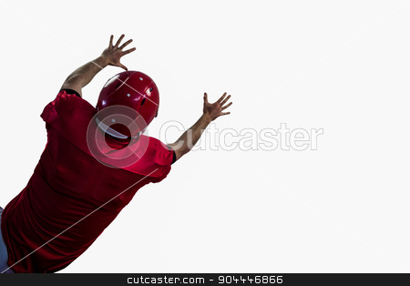 Rear view of american football player trying to catch football stock photo, Rear view of american football player trying to catch football against white background by Wavebreak Media