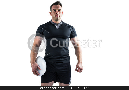 Tough rugby player holding ball stock photo, Tough rugby player holding ball on white background by Wavebreak Media