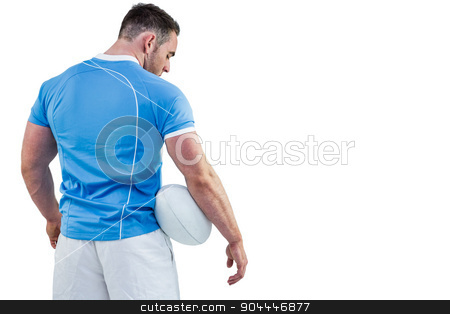 Rugby player standing with ball stock photo, Rugby player standing with ball on white background by Wavebreak Media