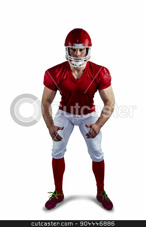 American football player looking at camera stock photo, American football player looking at camera on white background by Wavebreak Media