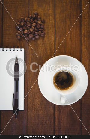 Cup of coffee and notepad with pen stock photo, Cup of coffee and notepad with pen on wooden table by Wavebreak Media