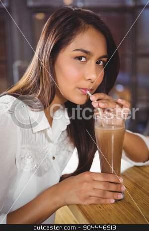 Portrait of a beautiful woman drinking a hot chocolate stock photo, Portrait of a beautiful woman drinking a hot chocolate in a cafe by Wavebreak Media