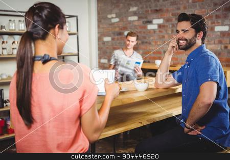 Waitress taking order with a tablet stock photo, Waitress taking order with a tablet at a cafe by Wavebreak Media