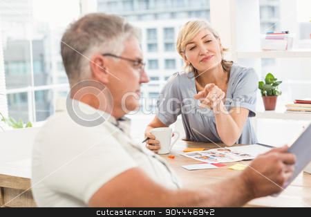 Businesswoman pointing at the tablet screen stock photo, Businesswoman pointing at the tablet screen at the office by Wavebreak Media