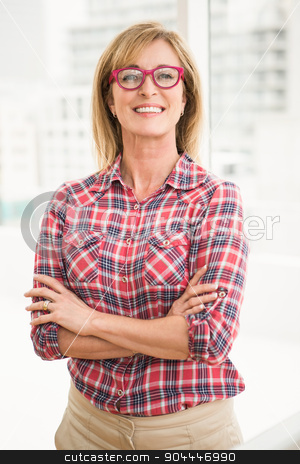 Smiling casual businesswoman with arms crossed stock photo, Portrait of smiling casual businesswoman with arms crossed in the office by Wavebreak Media